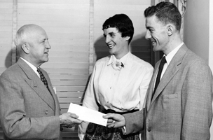 Two Silver Masque members,  Bernice Goldberg '55 and Tom Ryan '55, give a donation check to President Carl S. Ell, June 1956.