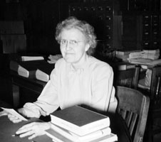 Myra White, Northeastern's first librarian, seated at her desk in the Berkeley Street YMCA.