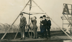 Civil Engineering students conducting triangulation survey from the YMCA roof, 1921.