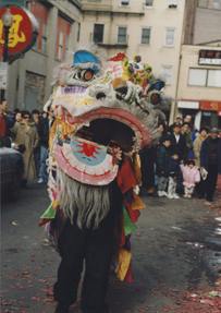 A man wears a dragon costume during a Chinese New Year.