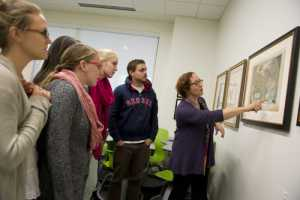 Students and professor viewing Arader maps in Snell Library